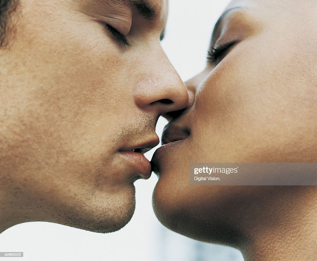 Close-Up of a Couple Kissing : Stock Photo