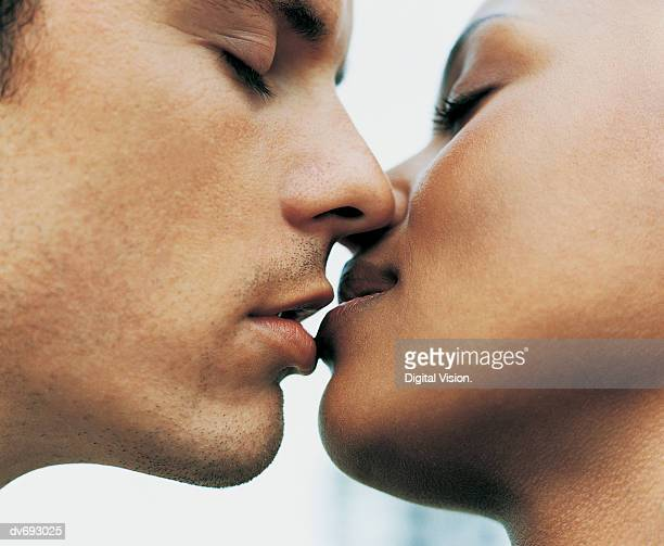 close-up of a couple kissing - black women kissing white men stock pictures, royalty-free photos & images