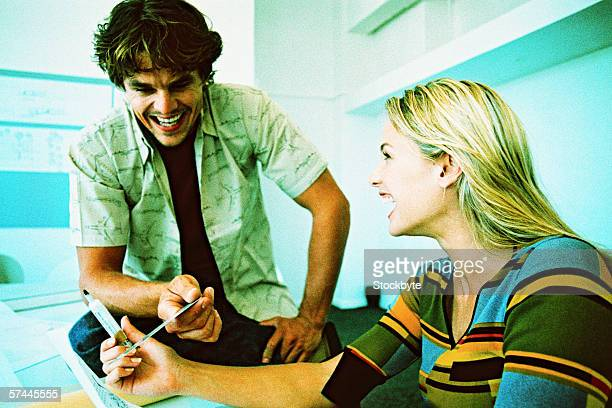 close-up of a couple laughing with each other at work