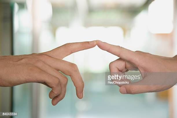 Close-up of a couple's fingers touching each other