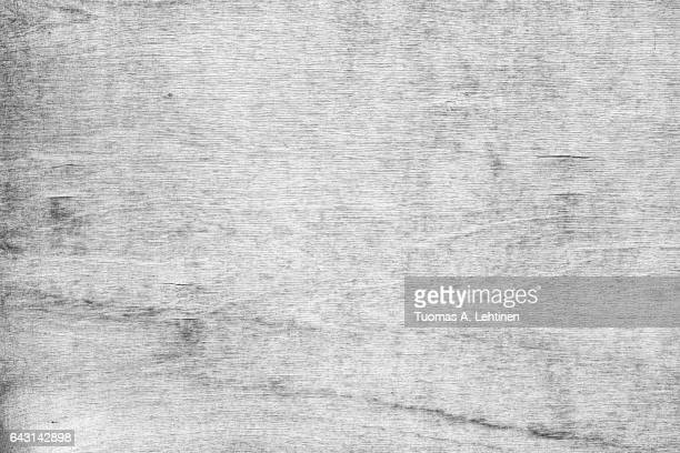 Close-up of a cracked and weathered plywood texture background.