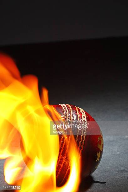 Close-up of a cricket ball burning