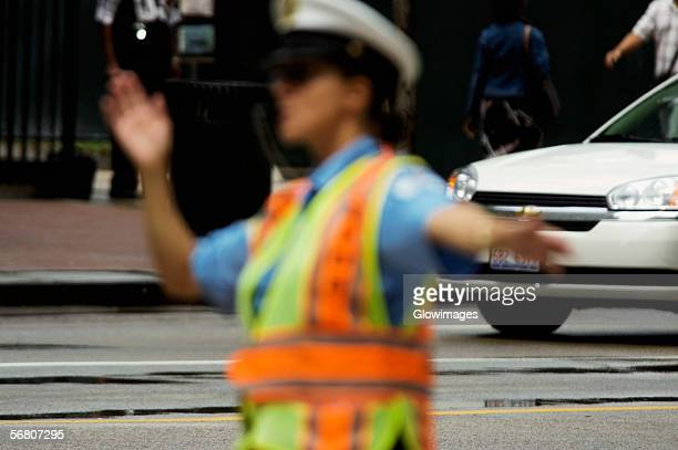 Close-up of a crossing guard directing traffic, Chicago, Illinois, USA