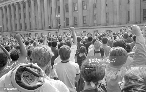 Close-up of a crowd of protestors, from the back, raising their fists during the Kent State/Cambodia Incursion Protest, Washington, District of...
