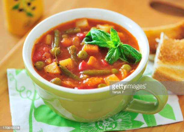 Close-up of a cup of minestrone soup