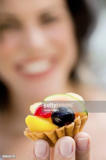 Close-up of a cupcake on a young woman's hand