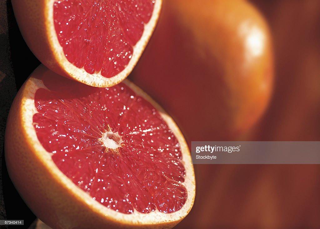 close-up of a cut open grapefruit : Stock Photo