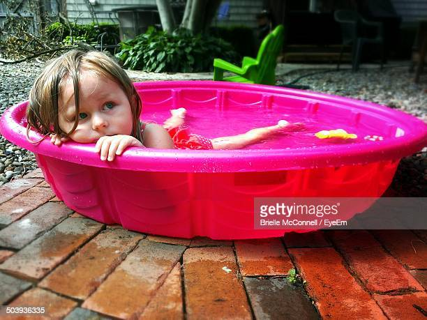 close-up of a cute girl in pink water tub - mcconnell stock pictures, royalty-free photos & images