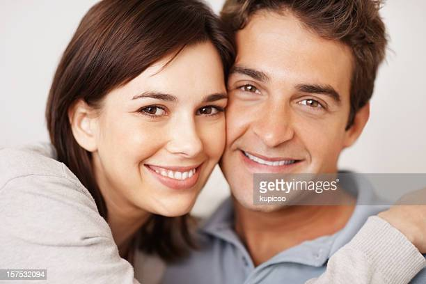 Closeup of a cute young couple smiling