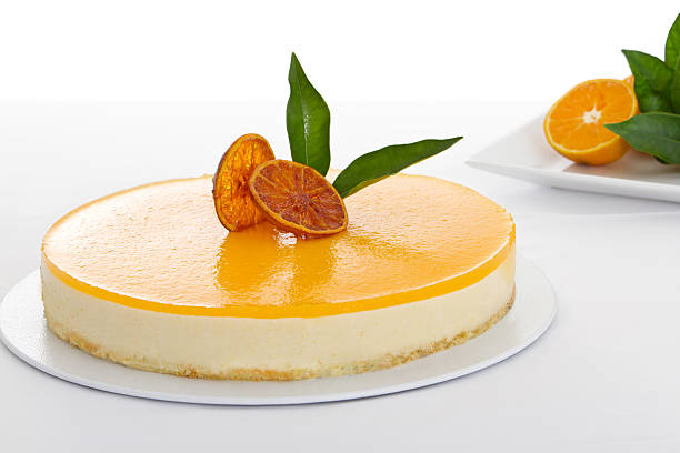 close-up of a delicious orange cheesecake - 芝士蛋糕 個照片及圖片檔
