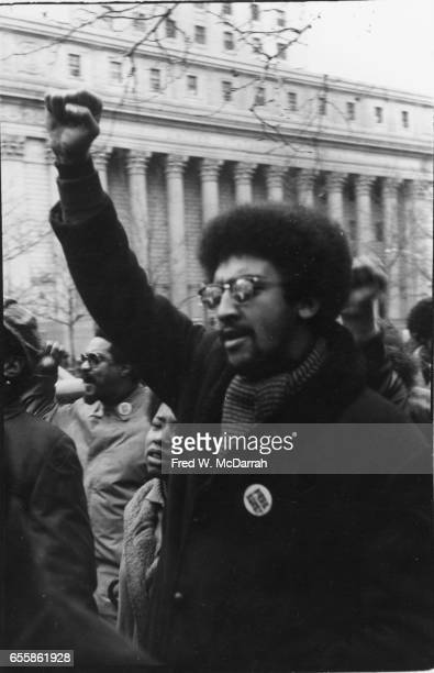 Closeup of a demonstrator with a raised fist at a protest near Federal courthouse to free the 'Panther 21' New York New York December 18 1969 The...