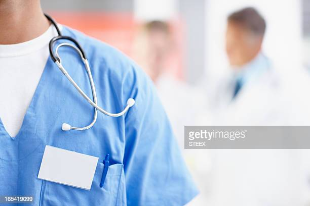 Close-up of a doctor in scrubs with stethoscope