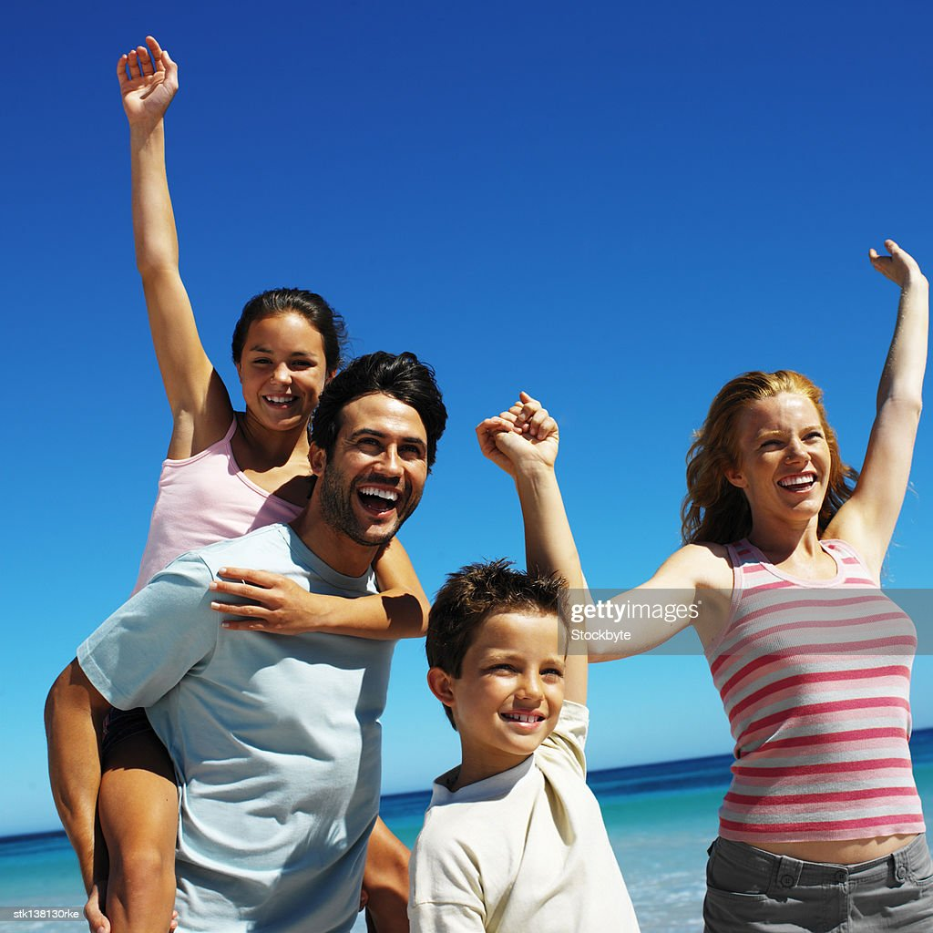 close-up of a family having fun at the beach : Stockfoto