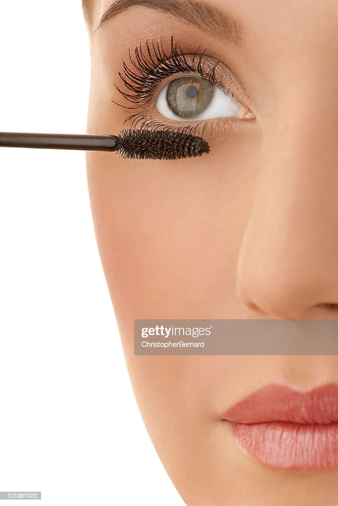 Close-up of a female applying make-up : Stock Photo