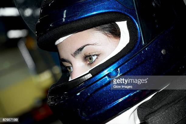 Close-up of a female race car driver wearing a crash helmet