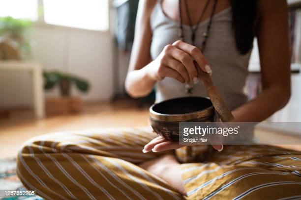 close-up of a female's hands holding a rin gong - gong stock pictures, royalty-free photos & images
