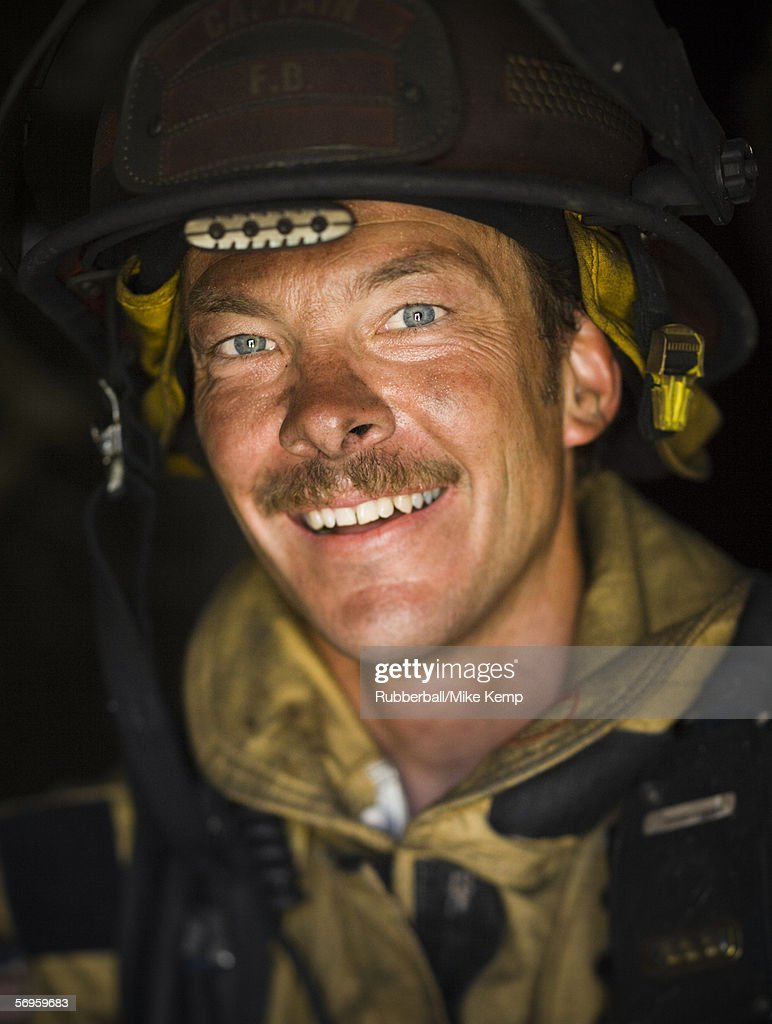 Close-up of a firefighter smiling : Stock Photo