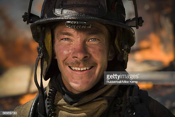 close-up of a firefighter smiling - disaster relief stock photos and pictures