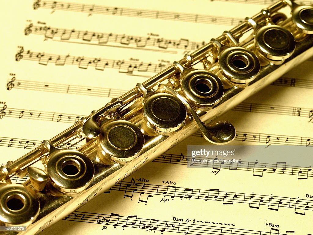 Closeup Of A Flute On A Sheet Music Stock Photo | Getty Images
