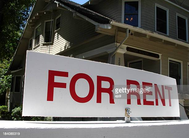 A close-up of a for rent sign in front of a California house