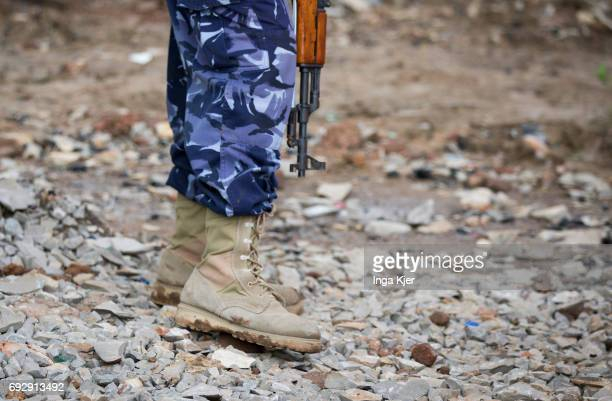 Closeup of a former militia fighter with a gun in the rehabilitation center for former AlShabaab militants on May 01 2017 in Baidoa Somalia