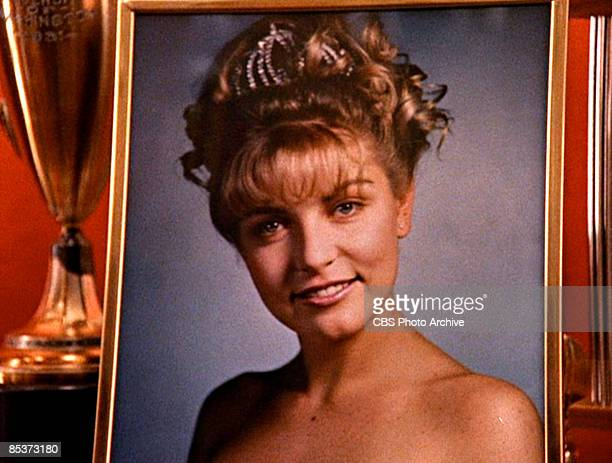 Closeup of a framed photograph of the character Laura Palmer as it sits in a display case in a scene from the pilot episode of the television series...