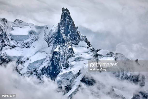 close-up of a french alps mountain peak with snow and clouds - monte bianco foto e immagini stock