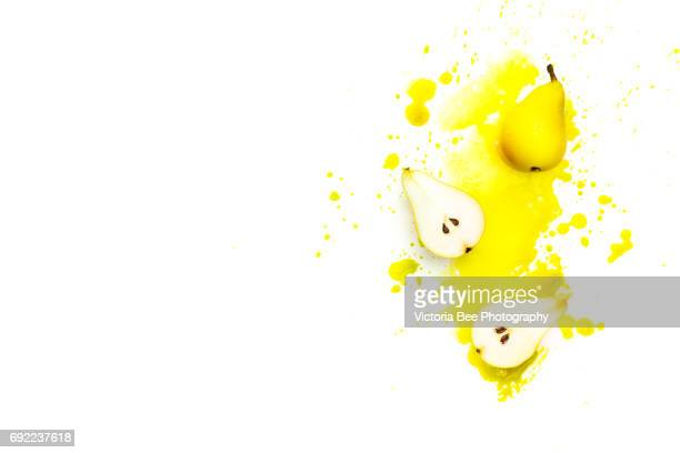 Close-up of a fresh yellow pear. Creative food shot with watercolor.