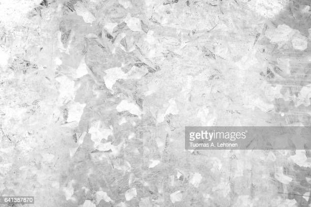 Close-up of a galvanized gray zinc plate texture background in black&white.