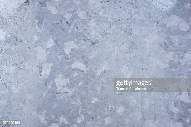 Close-up of a galvanized gray zinc plate texture