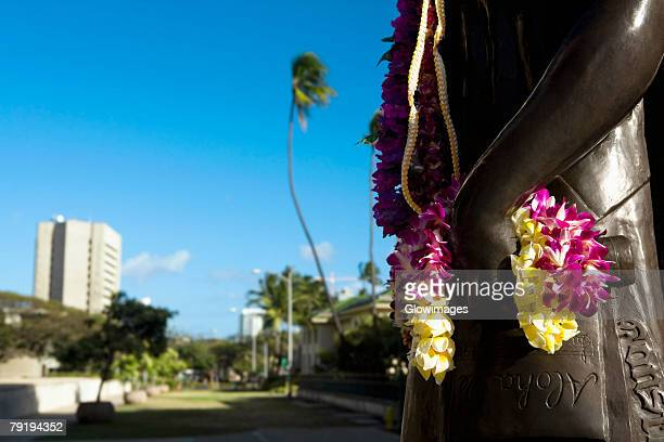 close-up of a garland hanging on a statue, honolulu, oahu, hawaii islands, usa - lei day hawaii stock pictures, royalty-free photos & images