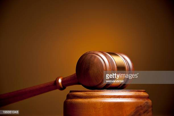 Closeup of a gavel resting on a podium