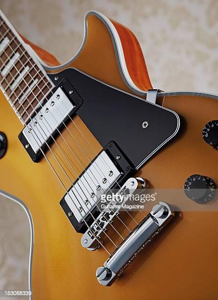 A closeup of a Gibson Les Paul Classic Custom electric guitar during a studio shoot for Guitarist Magazine February 1 2012