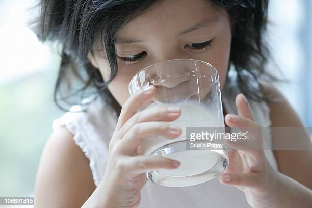 Close-up of a girl drinking milk