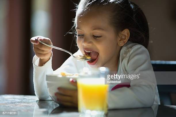 Close-up of a girl eating cereal