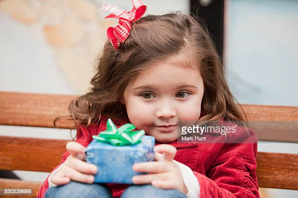 Close-up of a girl holding a Christmas gift