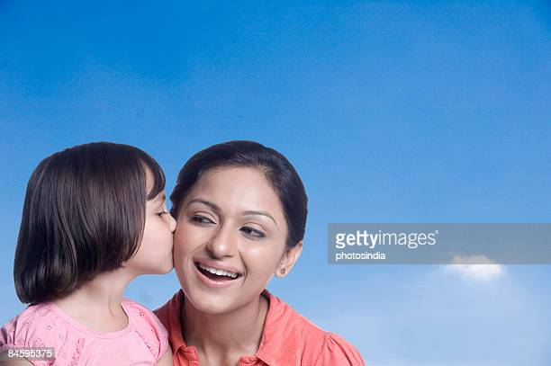 Close-up of a girl kissing her mother