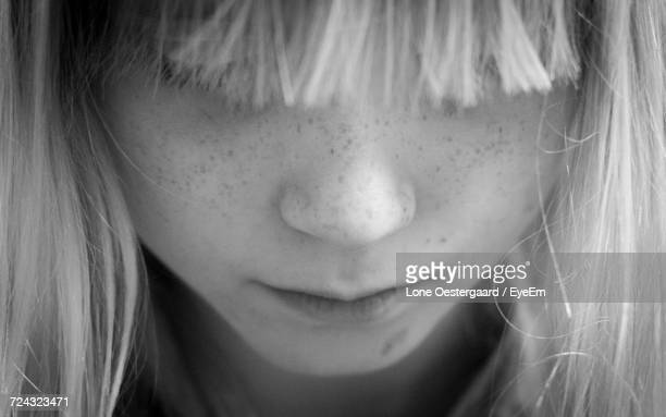 Close-Up Of A Girl Looking Down