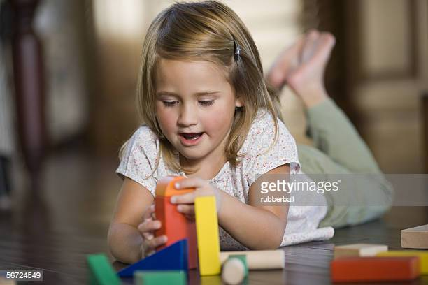 Close-up of a girl playing with blocks