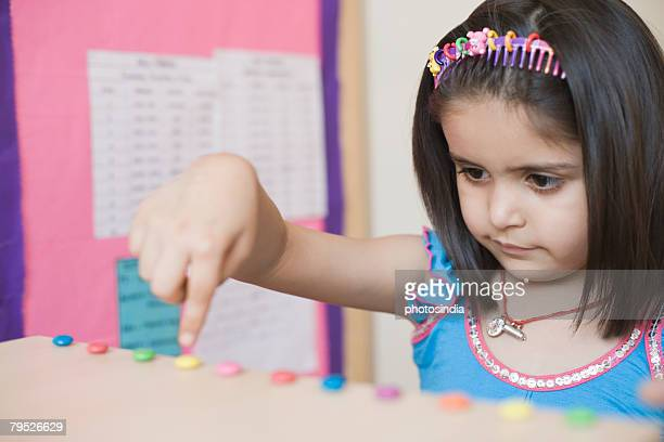 Close-up of a girl pointing at a candy