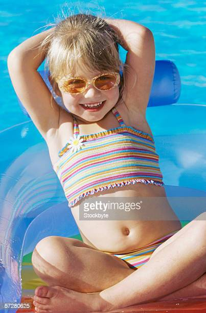 close-up of a girl reclining on an inflatable ring - navel stockfoto's en -beelden