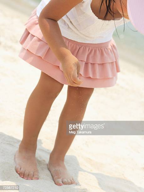 Close-up of a girl standing on the beach