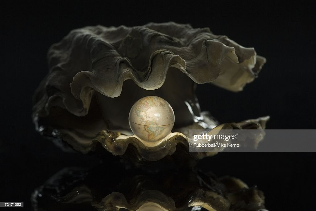Close-up of a globe in an oyster : Stock Photo