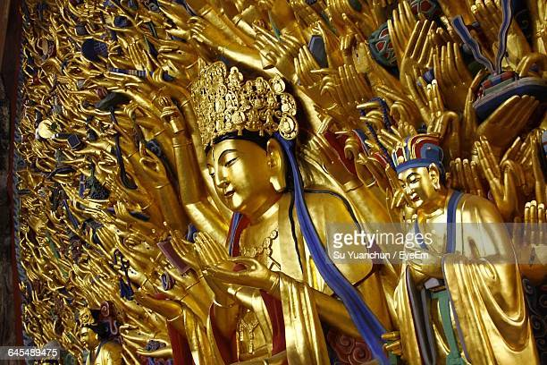 Close-Up Of A Golden Statues