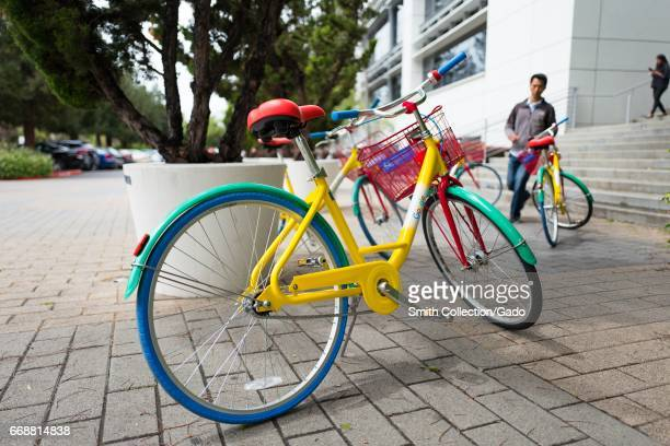 Closeup of a Google Bike with a Google staff member approaching in the background at the Googleplex headquarters of Google Inc in the Silicon Valley...