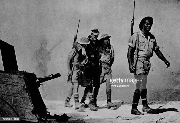 Closeup of a great battle The Australians are bringing in a wounded prisoner' from 'The Eighth Army' 1944 The Battle of El Alamein Egypt 1942