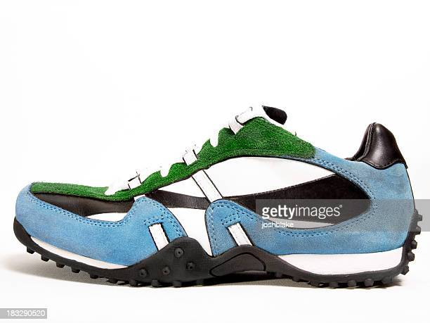 close-up of a green, white, black, and blue sneaker - suede shoe stock pictures, royalty-free photos & images