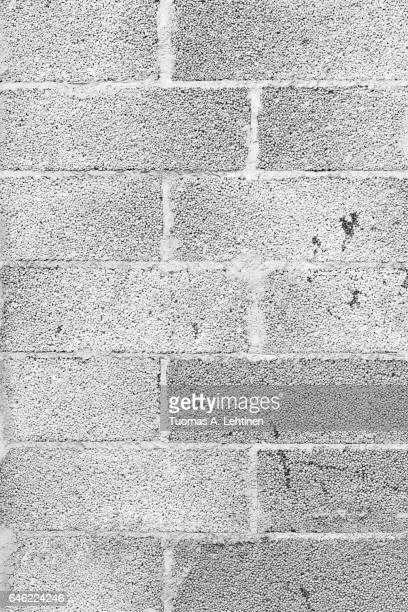 Close-up of a grey concrete block wall texture background in black&white.