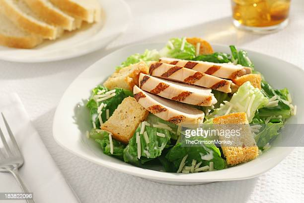 A close-up of a grilled chicken Caesar salad for lunch