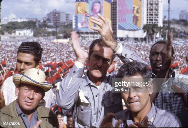 Closeup of a group of men in the audience as they applaud in la Plaza de la Revolucion during the 10th anniversary celebration of the Cuban...